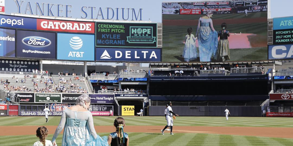 A Moment of Magic Founder walks to throw the first pitch on the Yankees Stadium.
