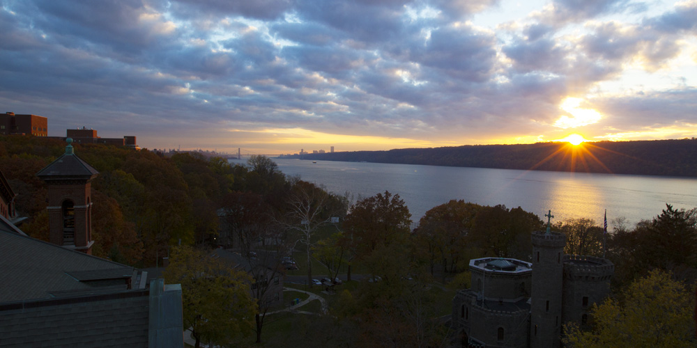 Aerial shot of the College of Mount Saint Vincent and the Hudson River at sunset