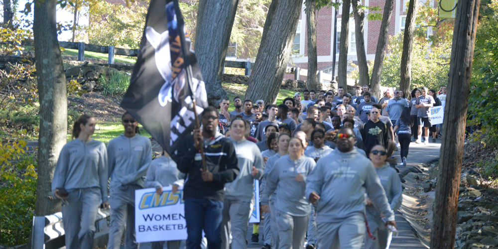 Athletic teams walk on campus.