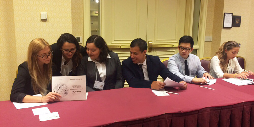 Mount students discuss a paper at the MAPACA conference