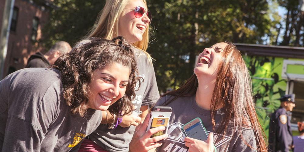 Three girls laughing at Orientation.