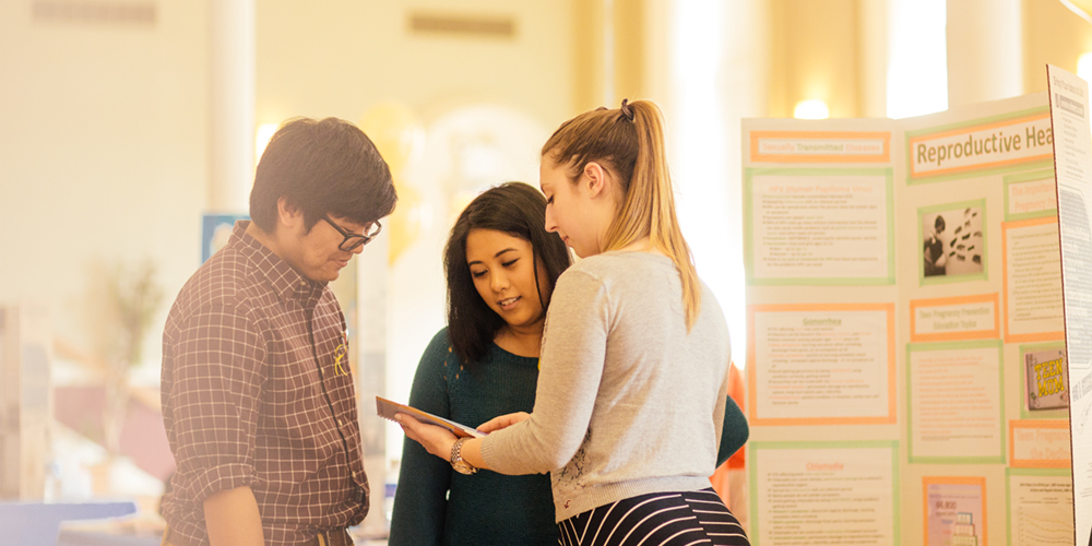 Students talk at a health conference.