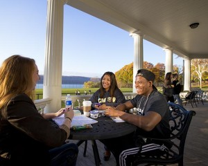 Student having breakfast on the Marivale Hall porch