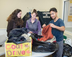 Students folding clothes in the Office of Campus Ministry