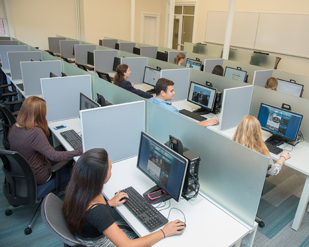 Students looking at their computers in the Fishlinger Center for Public Policy Research