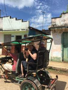 Mount faculty ride the bici taxi in Cuba