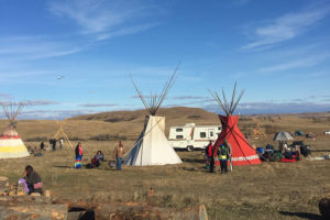 Overview of Standing Rock teepees on a sunny day.