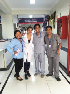 Leslie Peralta poses with Guatemalan doctors and a nurse.
