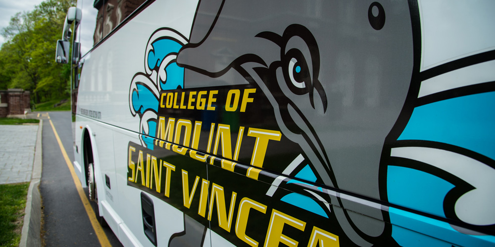 Image of the College of Mount Saint Vincent shuttle bus, featuring the Dolphin logo.