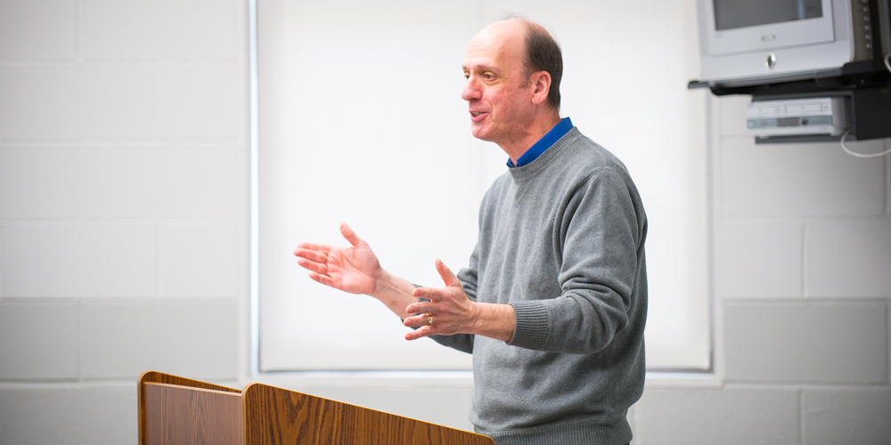 Dr. Vincent Fitzgerald teaches a class.