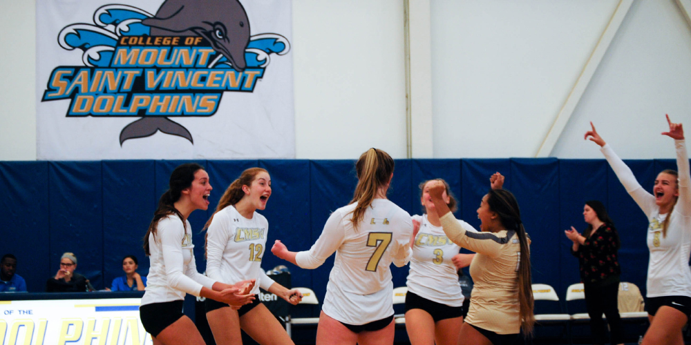 Women's Volleyball team celebrates skyline conference semifinals win.