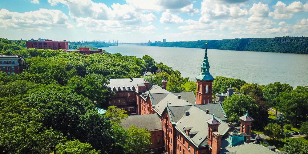Aerial view of the College of Mount Saint Vincent and the Hudson River, George Washington Bridge in the distance.