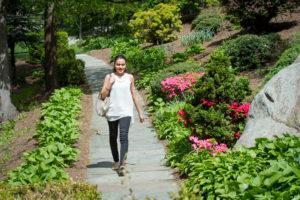Kat Perez walking on campus.