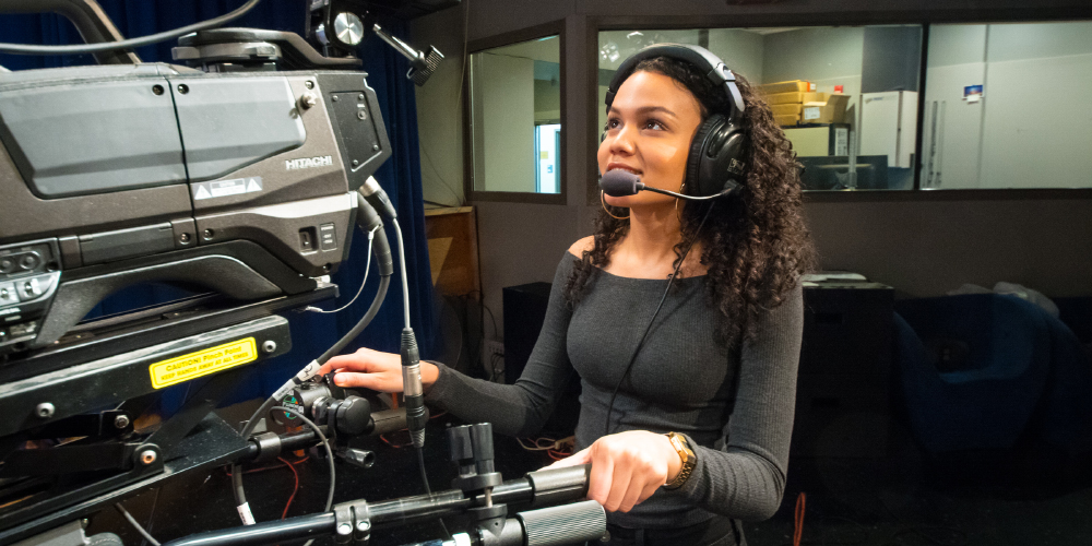 Kat Perez '19 in the TV studio with a microphone headset.