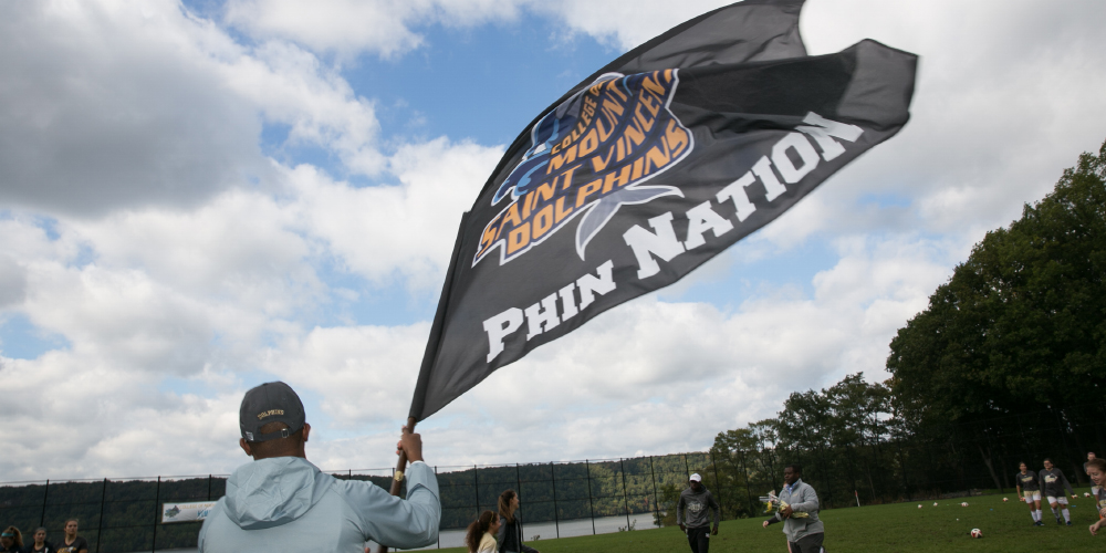 Student waves Phin Nation flag.