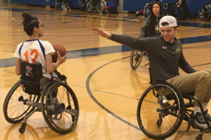 Two members of the Wheelchair Sports Federation play basketball.