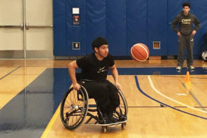 Wheelchair Sports Federation member plays basketball.
