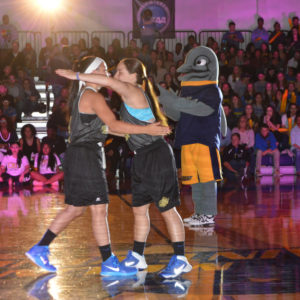 Students hug on the court.