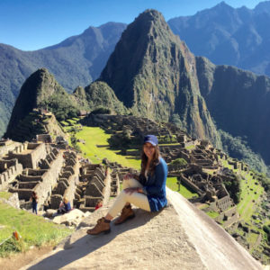 Student with Machu Pitcchu in the background.