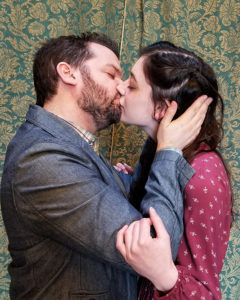 Two RMTG actors kiss on stage.