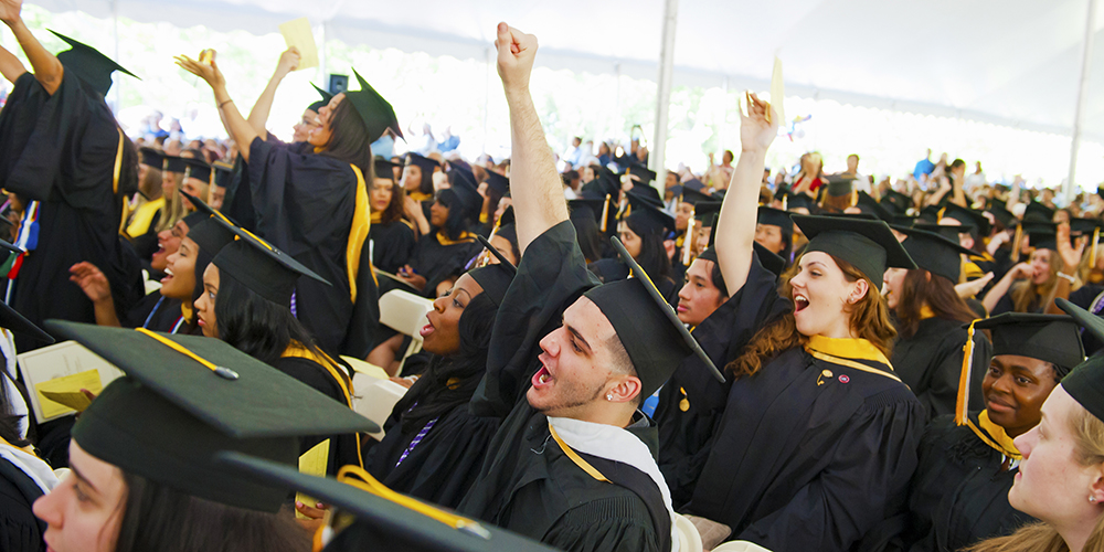Students cheer during the Commencement ceremony.