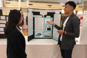 Two students discuss a presentation