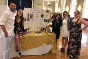 Students pose with their presentation.