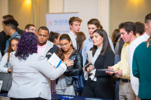 Students network at the Alumni Networking event in Smith Hall.