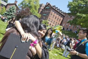 Graduate hugs family member.