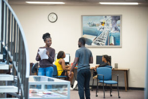 Two students talk in the Elizabeth Seton Library.