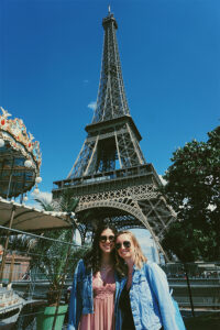 Danielle Quaranto and Nicole DeSouza with the Eiffel Tower in the background.