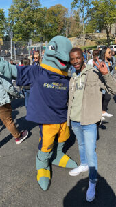Jaemon Williams with Vinny the Dolphin.