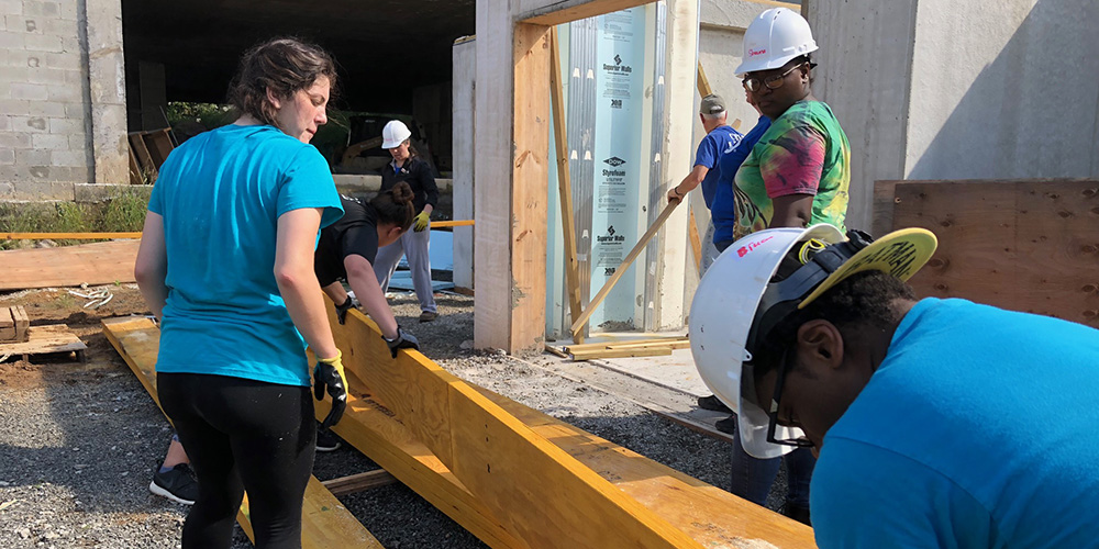 Students volunteer with Habitat for Humanity.