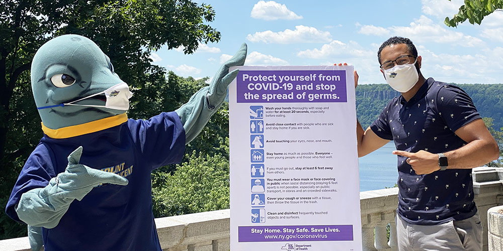 Vinny the Dolphin and Andrew Curiel show the guidelines while wearing protective masks.