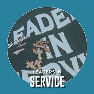 "Button saying ""Leaders in Service"""