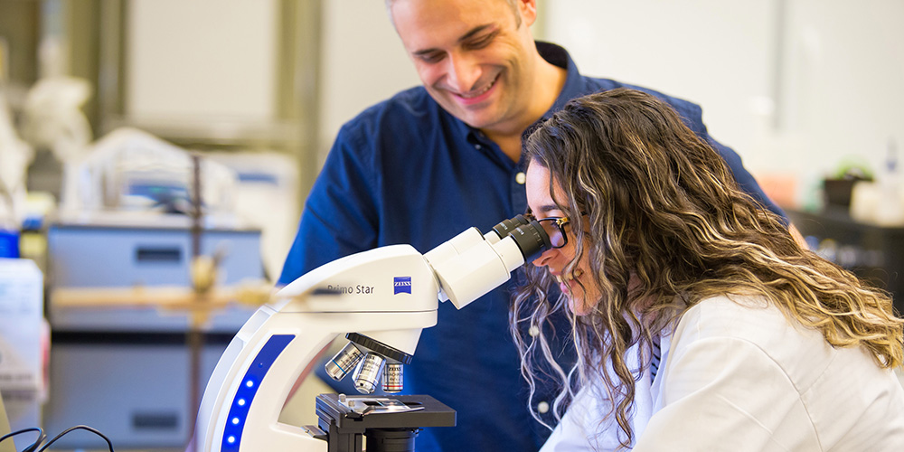 Professor working with a student in a laboratory.
