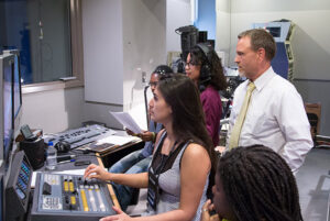 Michelle Ross with students in the Maryvale TV studio.