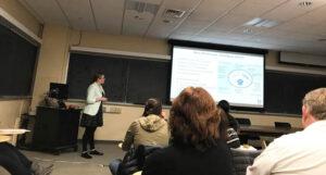 Joy Cote giving a scientific presentation.